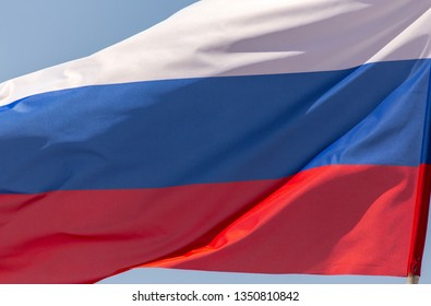 Flag of Russia against the blue sky.