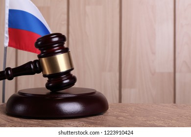 Flag of Russia and a gavel on a sounding block