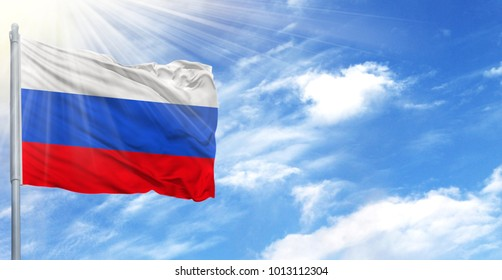 Flag of Russia on flagpole against the blue sky