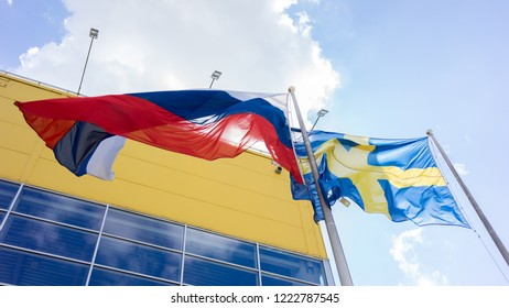 Flag of Russia and Sweden near the Ikea store in Moscow