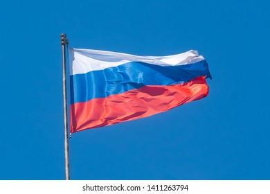 flag of the Russian Federation against the blue sky