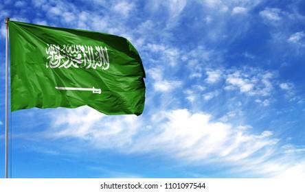 Flag of Saudi Arabia on flagpole against the blue sky