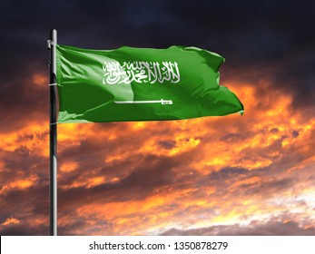 flag of Saudi Arabia on flagpole fluttering in the wind against a colorful sunset sky
