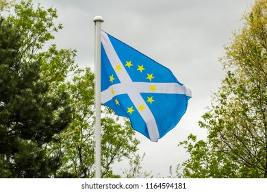 The Flag of Scotland, also known as Saint Andrew's Cross or the Saltire with Yellow European Union Stars in the Center.
