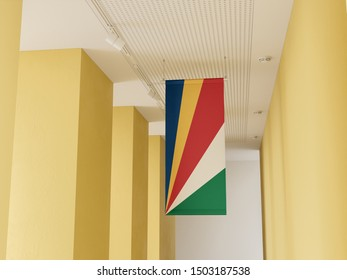 Flag of Seychelles hanging in gallery. Seychelles Flag displayed in gallery.