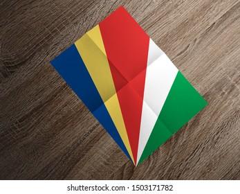 Flag of Seychelles on paper. Seychelles Flag on wooden table.