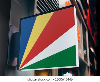 Flag of Seychelles on Shop Sign. Flag of Seychelles on Advertisement Board