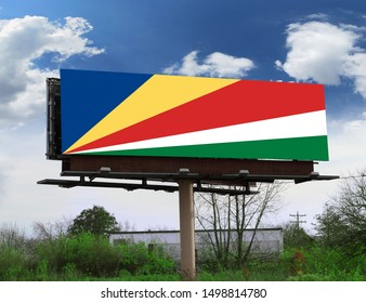 Flag of Seychelles on wooden board. Paper Flag of Seychelles on wooden table.