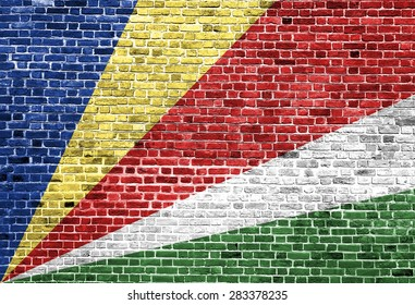 Flag of Seychelles painted on brick wall, background texture