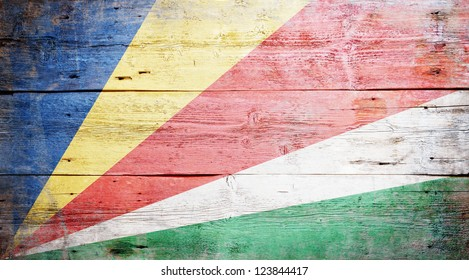 Flag of the Seychelles painted on grungy wood plank background