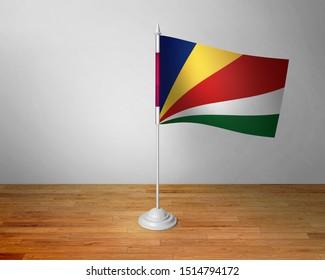 Flag of Seychelles Table. Seychelles Desk Flag on Wooden Table.