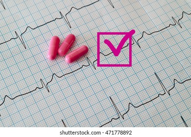 Flag sign, capsules and  cardiogram heart background