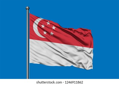 Flag of Singapore waving in the wind against deep blue sky. Singaporean flag.