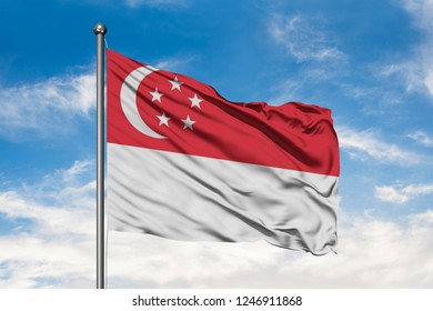 Flag of Singapore waving in the wind against white cloudy blue sky. Singaporean flag.