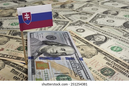 Flag of Slovakia sticking in a variety of american banknotes.(series)