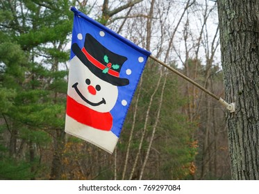 Flag with snowman hanging outdoor