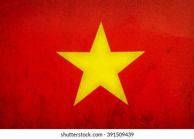 Flag of The Socialist Republic of Vietnam on old wall texture background.
