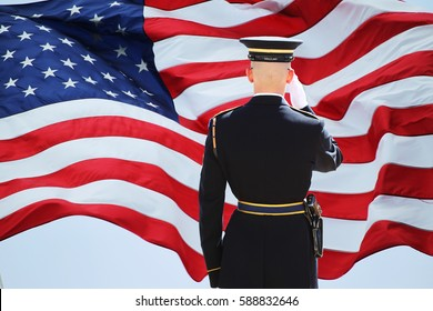 Flag and soldier saluting