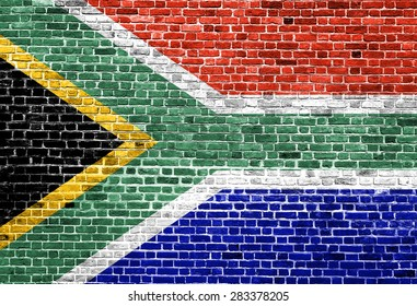 Flag of South Africa painted on brick wall, background texture