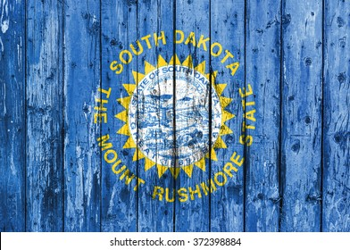 Flag of South Dakota painted on wooden frame
