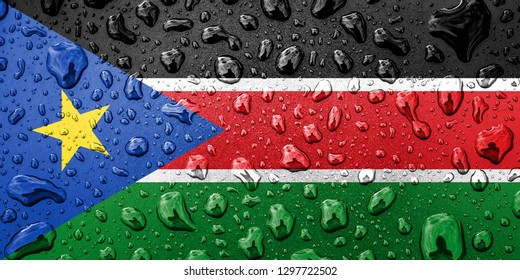 Flag of South Sudan on a metallic background. The South Sudanese flag with rain droplets