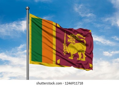 Flag of Sri Lanka waving in the wind against white cloudy blue sky. Sri Lankan flag.