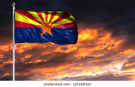 flag State of Arizona on flagpole fluttering in the wind against a colorful sunset sky