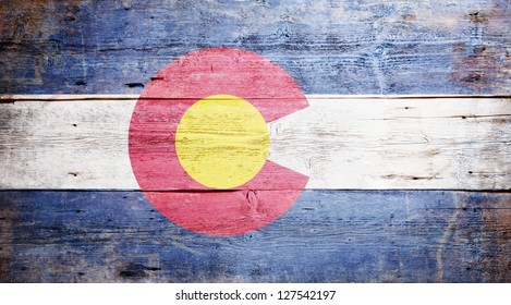 Flag of the state of Colorado painted on grungy wooden background