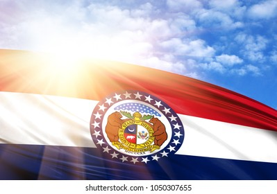flag of State of Missouri against the blue sky with sun rays