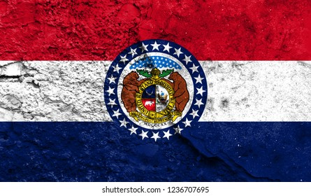 Flag State of Missouri close up painted on a cracked wall, concept of armed actions and conflicts in the world