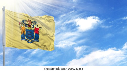 Flag of State of New Jersey on flagpole against the blue sky