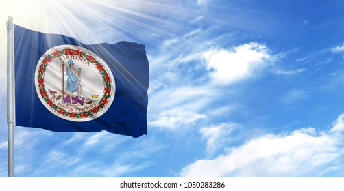 Flag of State of Virginia on flagpole against the blue sky