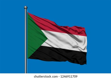 Flag of Sudan waving in the wind against deep blue sky. Sudanese flag.