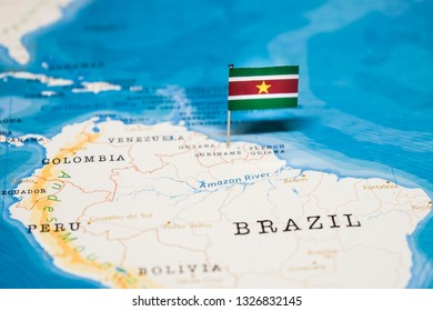 the Flag of suriname in the world map