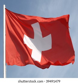 Flag of Switzerland over a blue sky