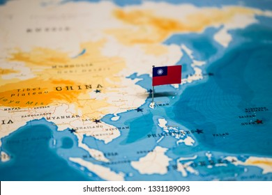 the Flag of taiwan on taipei in the world map