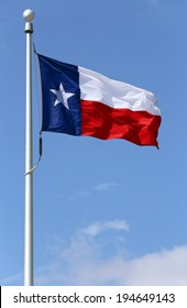 The flag of Texas blowing in the wind.