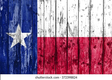 Flag of Texas painted on wooden frame