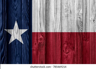 Flag of Texas state (USA) on wood texture background