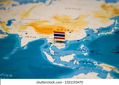 the Flag of thailand on bangkok in the world map