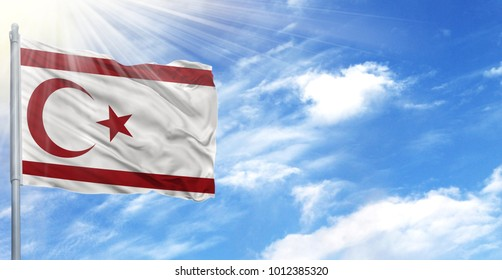 Flag of Turkish Republic of Northern Cyprus on flagpole against the blue sky