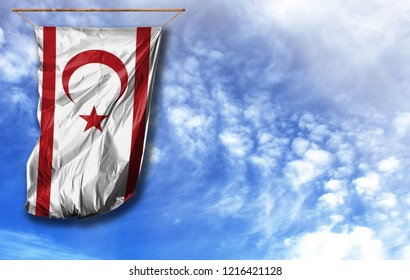 Flag of Turkish Republic of Northern Cyprus. Vertical flag, against blue sky with place for your text
