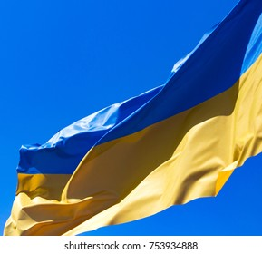 flag of Ukraine against the blue sky .