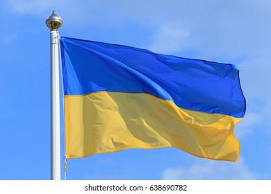 Flag of Ukraine on blue sky background.