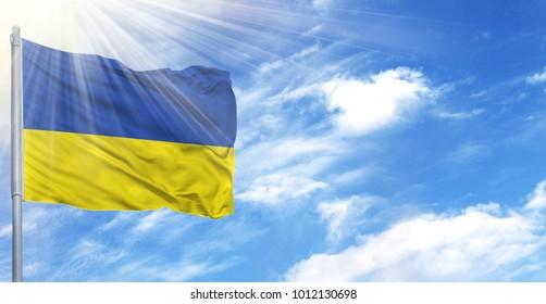 Flag of Ukraine on flagpole against the blue sky