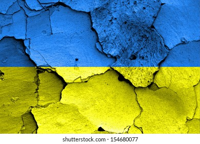 flag of Ukraine painted on cracked wall