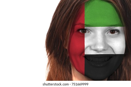 Flag of the United Arab Emirates on the face of a woman, isolated on white background.