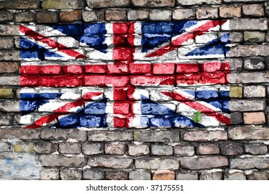 Flag of the United Kingdom on an old brick wall with small ivy plant growing out of a crack.