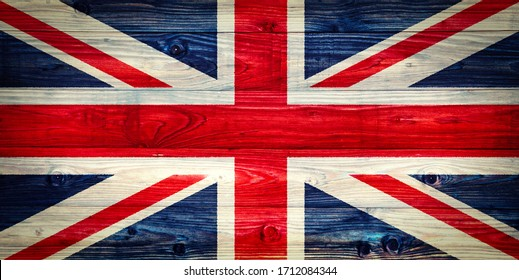 The Flag of the United Kingdom on a weathered wooden wall