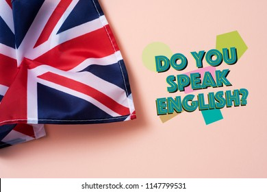 a flag of the United Kingdom and the question do you speak English? on a salmon pink background
